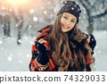Winter young woman portrait. Beauty Joyful Model Girl laughing and having fun in winter park. Beautiful young female outdoors, Enjoying nature, wintertime 74329033