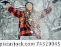 Winter young woman portrait. Beauty Joyful Model Girl laughing and having fun in winter park. Beautiful young female outdoors, Enjoying nature, wintertime 74329045