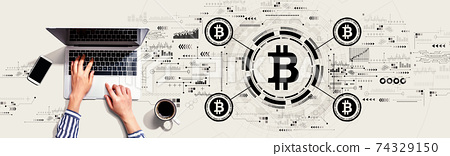 Bitcoin theme with person using laptop 74329150