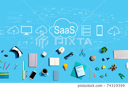 SaaS - software as a service concept with electronic gadgets and office supplies 74329399