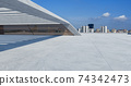 Perspective view of empty concrete floor and modern rooftop building 74342473