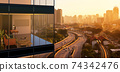 Panoramic view of beautiful evening cityscape 74342476