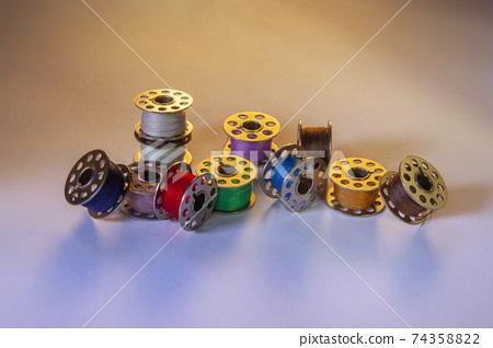 Selection of metal sewing machine bobbins 74358822