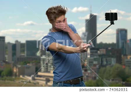 Teen boy is nd making selfie. 74362031