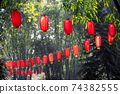 Red chinese lanterns hanging in a park 74382555