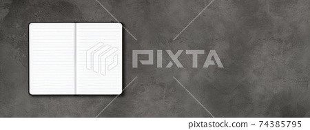 Black open lined notebook isolated on dark concrete background. Horizontal banner 74385795