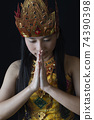Indonesian Girl Dressed In Traditional Javanese Outfit With Her Hands In A Greeting Gesture 74390398