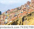 Slum houses built in steep slope of La Paz, Bolivia 74392788