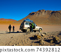 Off-road SUV with tourist on Altiplano 74392812