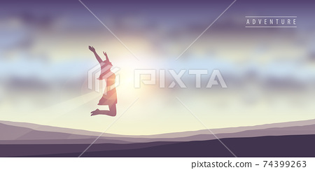happy girl with raised arms jumps at sunshine 74399263
