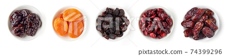Various dried fruits in bowl isolated on white, from above 74399296