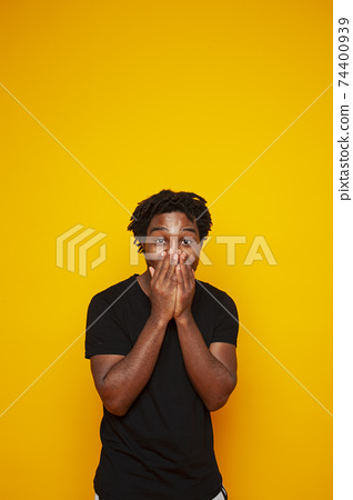 young handsome african american guy student posing cheerful and gesturing on yellow background, lifestyle people concept 74400939