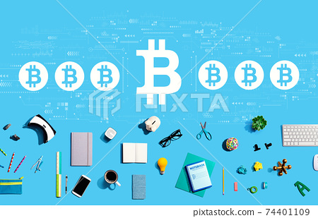 Bitcoin theme with electronic gadgets and office supplies 74401109
