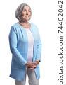 Smiling beautiful senior woman posing isolated on white background 74402042