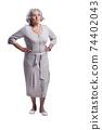 Sad senior woman posing isolated on white background 74402043