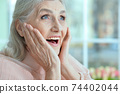 Close up portrait of happy senior woman 74402044
