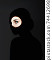 beautiful girl in the dark. woman with shadow on her face 74412698