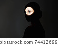 silhouette of beautiful girl in the dark. young woman with shadow on the face 74412699