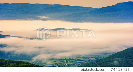 glowing fog in the rural valley at dawn. beautiful mountain landscape in springtime. view from the hill 74418412