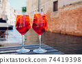 Two glasses of Spritz Veneziano cocktail served near the Venetian canal. 74419398
