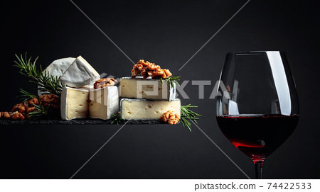 Red wine and soft cheeses with walnuts and rosemary. 74422533