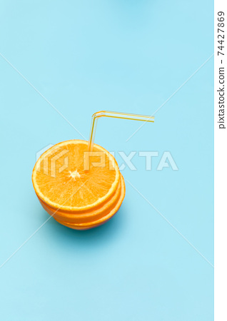 fresh orange juice with straw. 74427869