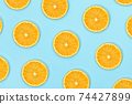 ripe slice orange fruit on blue background 74427899