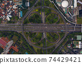 Top down overhead aerial view of large multi lane roundabout in Jakarta, Indonesia Large traffic junction on a highway with car traffic 74429421