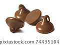 Milk chocolate drops or chips isolated on white background 74435104