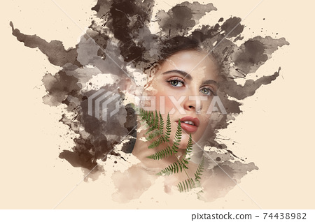 Portrait of a beautiful brunette girl showing through watercolor paints on a beige background 74438982