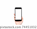Hand holding smartphone mockup of blank screen on isolated. Take your screen to put on advertising. 74451032