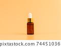 Medicine bottle placed, Blank label package for mockup on the orange background. 74451036