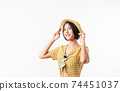 woman in yellow color dress and wearing a hat and stand on white background. 74451037