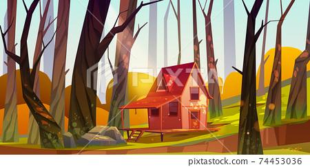Wooden stilt house in autumn forest. Old shack 74453036