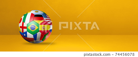 Football soccer ball with national flags on a yellow studio banner 74456078