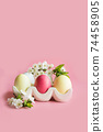 Colorful eggs with spring flowers in porcelain box. Easter. Spring. Close up. 74458905