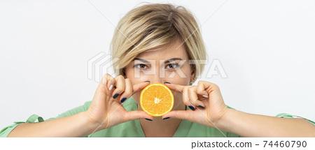 Dietitian holding slice of orange 74460790