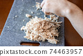 A man slicing boiled chicken breast 74463957