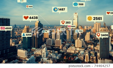Social media icons fly over city downtown showing people engagement connection 74464257