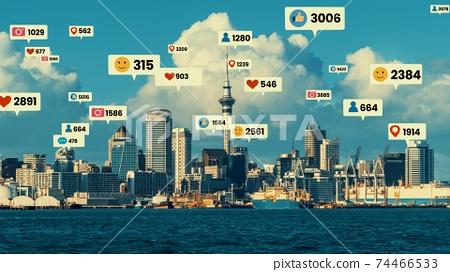 Social media icons fly over city downtown showing people engagement connection 74466533