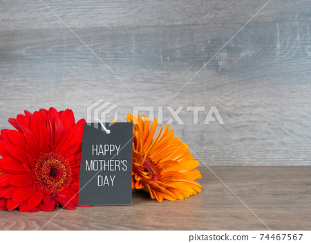 happy mother's day, greetings card with two gerberas and black craft paper card 74467567