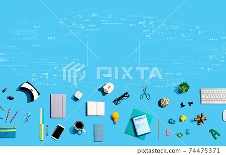 Technology screen with electronic gadgets and office supplies 74475371