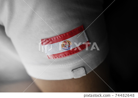 Patch of the national flag of the French Polynesia on a white t-shirt 74482648