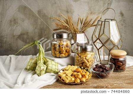 ketupat and snacks for eid mubarak 74484860