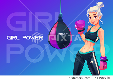 Woman in boxing gloves posing at punching bag 74490516
