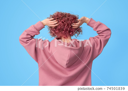 Back of young woman with pink hair 74501839