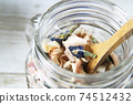 Butterfly pea and lemongrass dry herbal tea in a glass jar 74512432