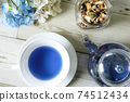 Butterfly pea blue herbal tea in a glass teapot and teacup 74512434