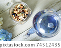 Butterfly pea blue herbal tea in a glass teapot 74512435