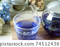 Butterfly pea blue herbal tea in a glass teapot and cup 74512436